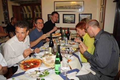 Group enjoying italian dinner